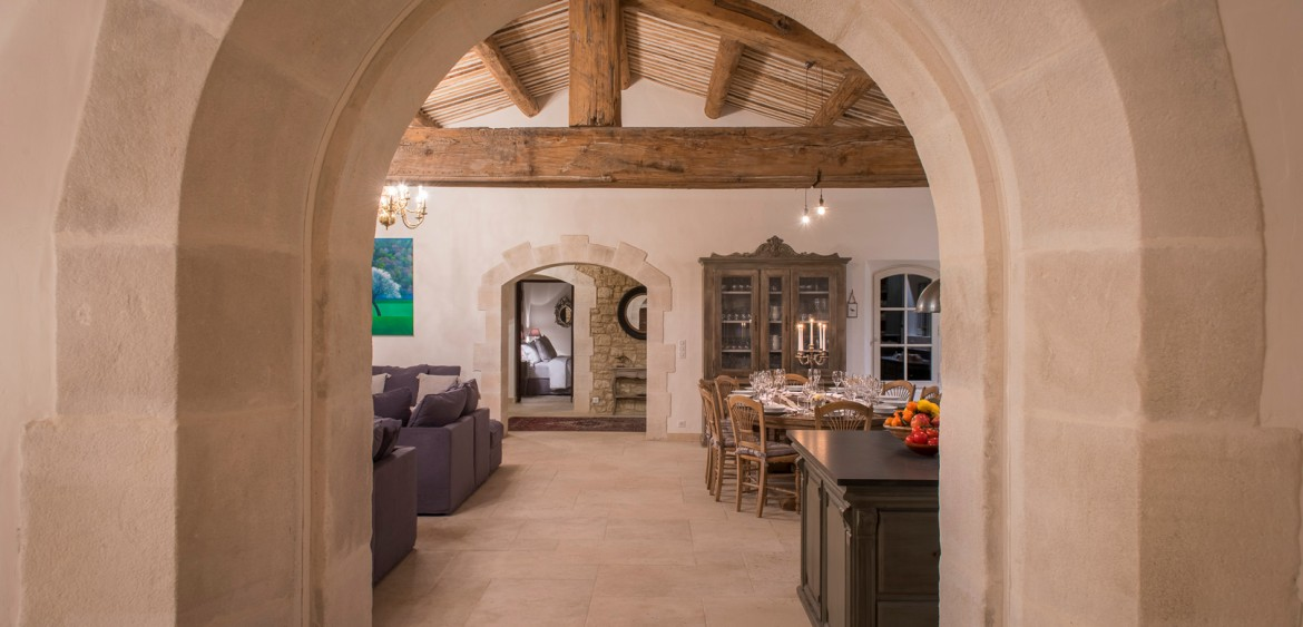 Through an large stone archway into the living and dining area