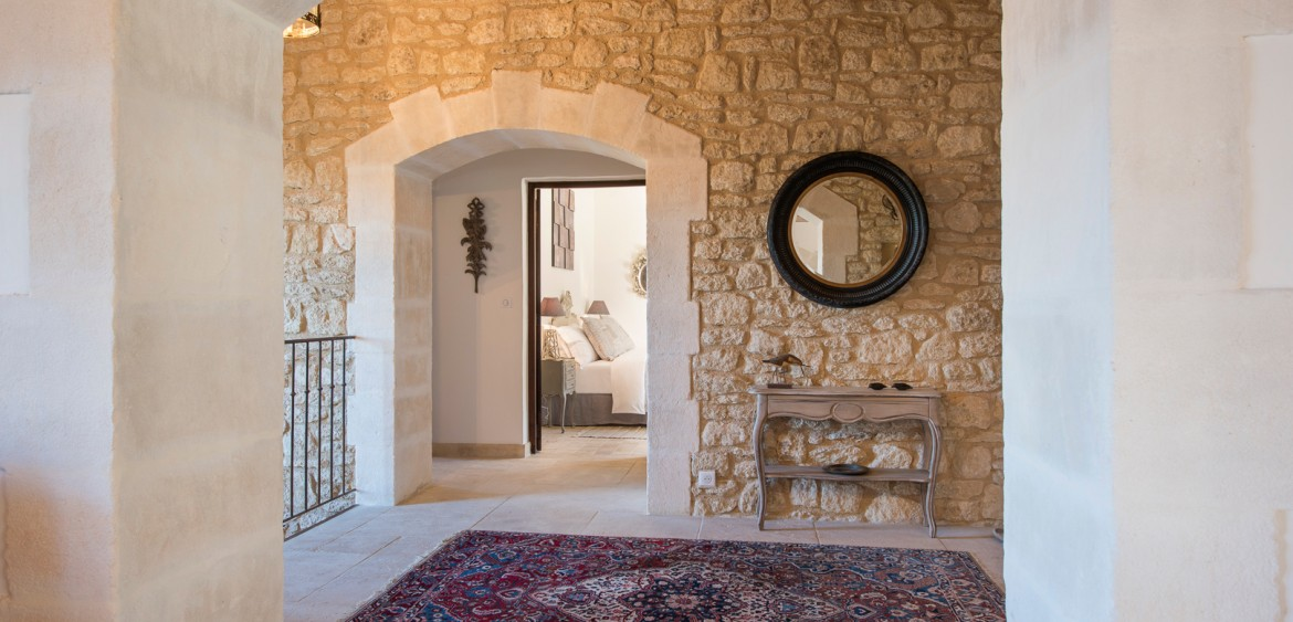 Oriental rug on the landing of a large Provençal villa with a view to the bedroom