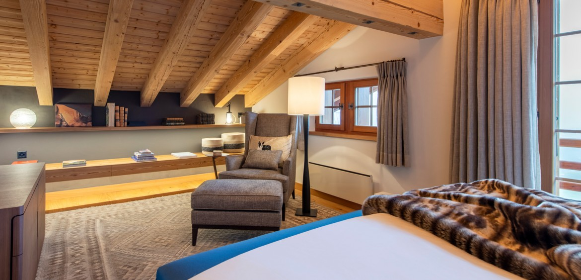 An armchair to the back of the Master Suite at the Verbier chalet