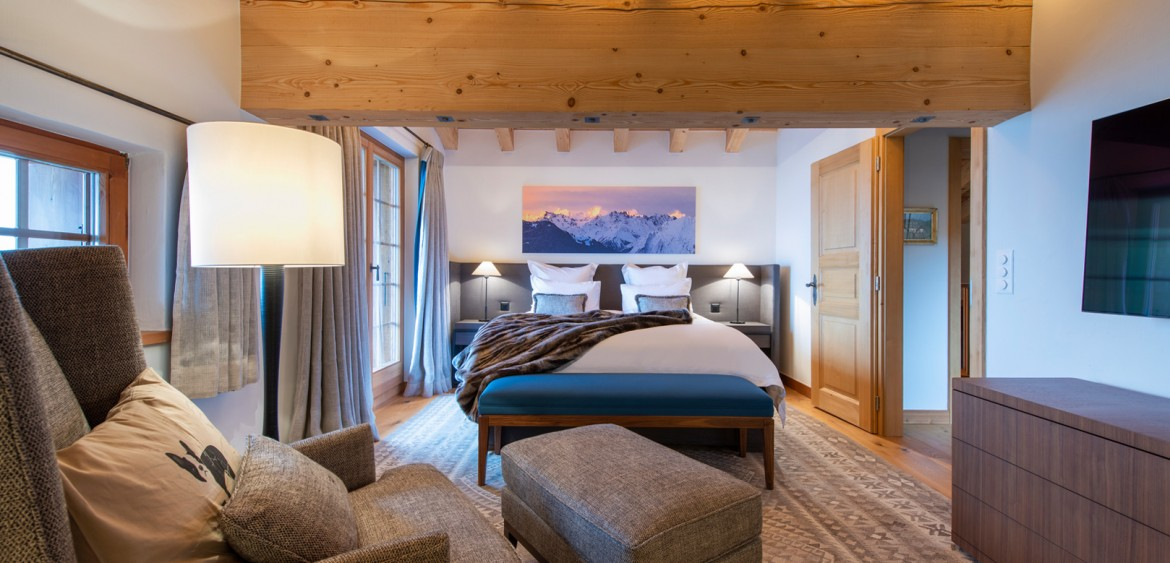 The Master Suite at the Verbier chalet, looking through the seating area to the large double bed at the rear of the room